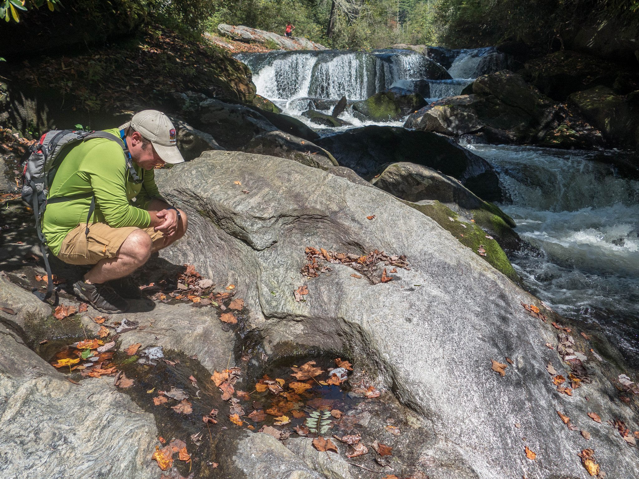 Professor Brian Byrd of Eastern Carolina University inspects rock pool on upper Chattooga River at Bull Pen rapid