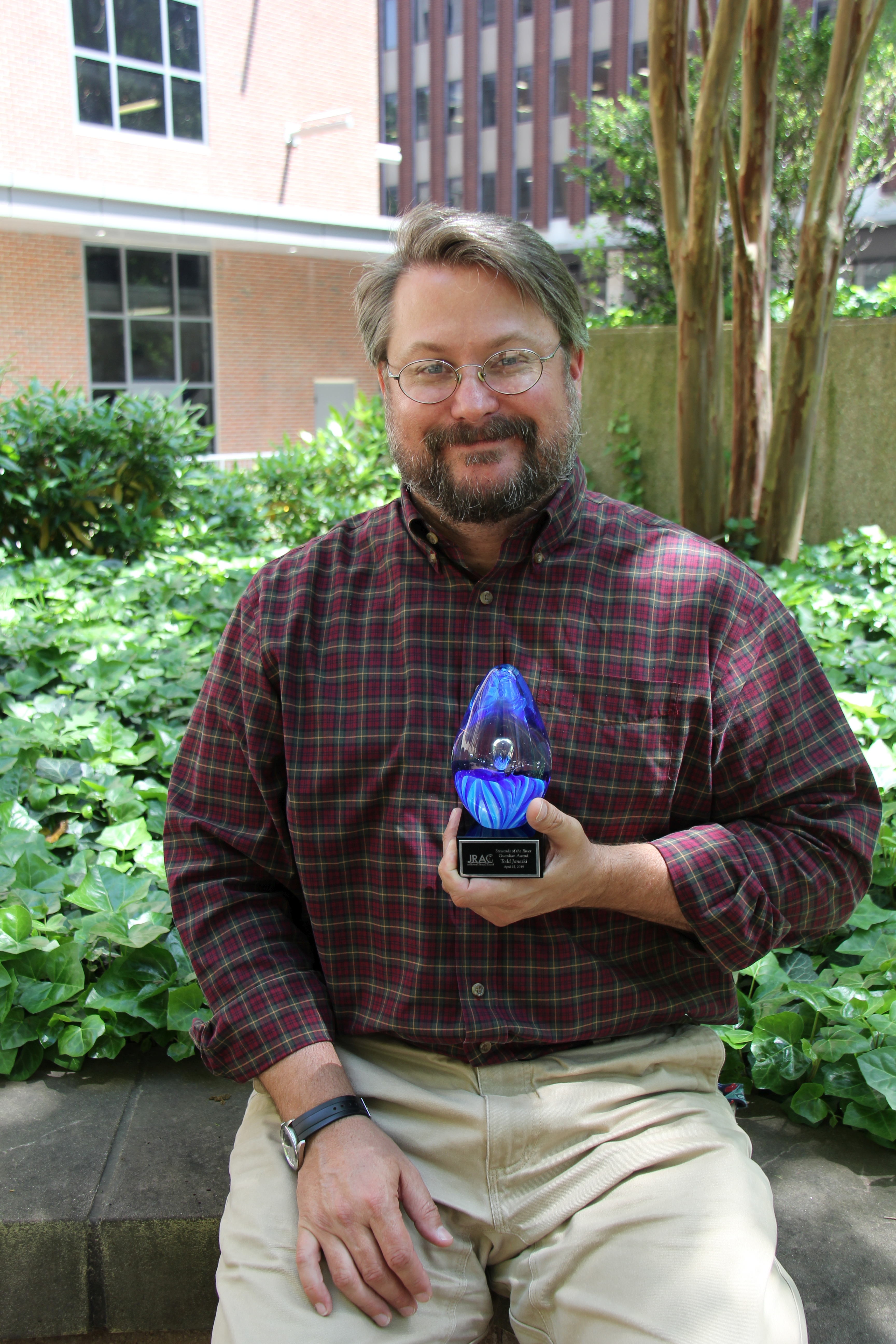 VOSRP Director Todd Janeski holding his 'Stewards of the River' award from JRAC