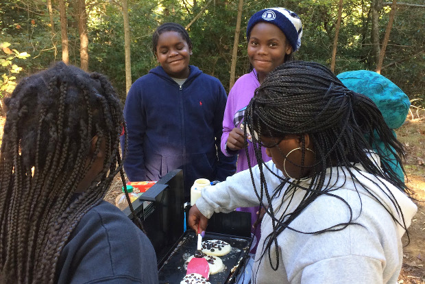Blue Sky Fund Students prepare chocolate pancakes during a camping trip in October at the Rice Rivers Center. Blue Sky Fund and Rice Rivers Center have collaborated to help Richmond's youth explore the outdoors and learn environmental science.  Contributed photos courtesy Blue Sky Fund
